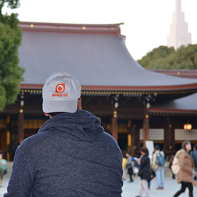 Man in cap in front of Pagoda