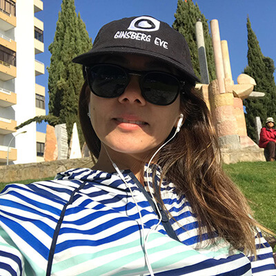 Woman wearing Ginsberg hat and headphones