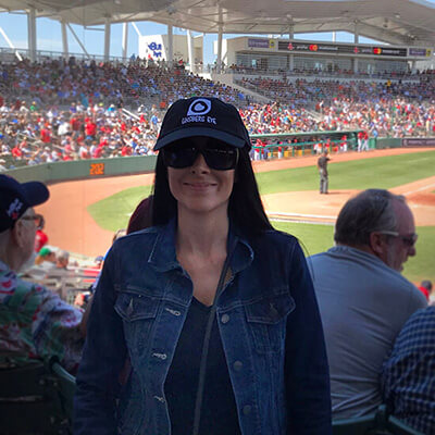 Woman wearing Ginsberg Hat at baseball game