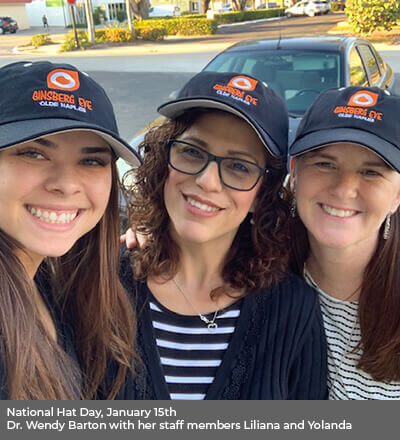 Three women wearing ginsberg hat smiling outdoors