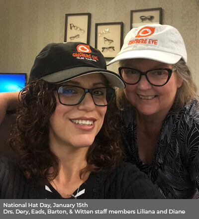 Two women wearing ginsberg hat and glasses