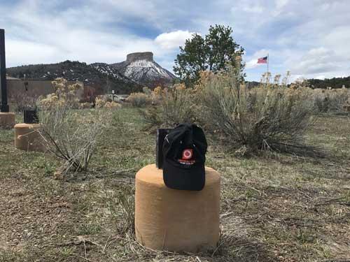 Hat on post in desert