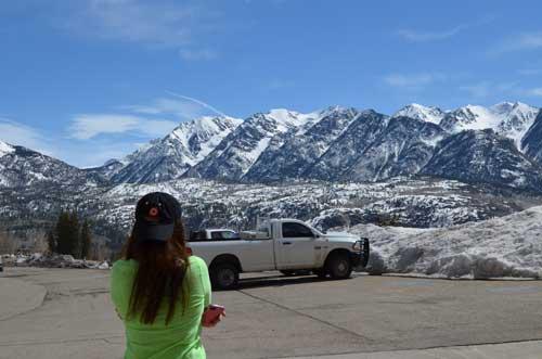 Woman looking at mountains wearing ginsberg hat
