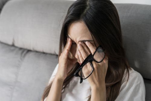 Woman wiping eyes from dry eye