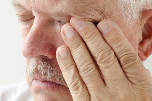 Elderly man suffering from a corneal injury
